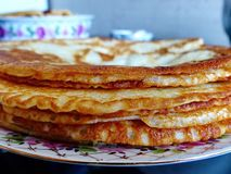 Russian blini pancakes, apple jam and condensed milk. Celebration of Maslenitsa. Maslenitsa. Is an Eastern Slavic traditional holiday. Orthodox tradition of royalty free stock photos