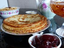 Russian blini pancakes, apple jam and condensed milk. Celebration of Maslenitsa. Maslenitsa. Is an Eastern Slavic traditional holiday. Orthodox tradition of royalty free stock photography