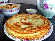 Russian blini pancakes, apple jam and condensed milk. Celebration of Maslenitsa. Maslenitsa. Is an Eastern Slavic traditional holiday. Orthodox tradition of royalty free stock image