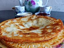Russian blini pancakes, apple jam and condensed milk. Celebration of Maslenitsa. Maslenitsa. Is an Eastern Slavic traditional holiday. Orthodox tradition of stock photo