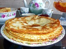 Russian blini pancakes and apple jam, condensed milk, honey. Celebration of Maslenitsa. Maslenitsa is an Eastern stock images