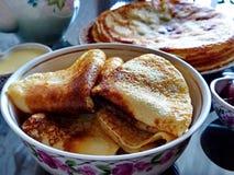 Russian blini pancakes and apple jam, condensed milk, honey. Celebration of Maslenitsa. Maslenitsa is an Eastern. Slavic traditional holiday. Selective focus stock photo