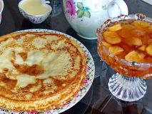 Russian blini pancakes and apple jam, condensed milk, honey. Maslenitsa is an Eastern Slavic traditional holiday. royalty free stock images