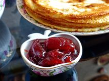 Russian blini pancakes and apple jam, condensed milk, honey. Maslenitsa is an Eastern Slavic traditional holiday. stock images