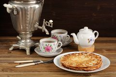 Russian bliny with vintage samovar and teaware Royalty Free Stock Photo