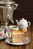 Russian bliny with vintage samovar and teaware royalty free stock images