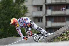 Russian BMX Cruiser Championship 2015. St. Petersburg, Russia - August 6, 2015: Unidentified biker on the berm in the BMX race Cruiser. The competitions is a Stock Photos