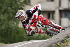 Russian BMX Cruiser Championship 2015. St. Petersburg, Russia - August 6, 2015: Unidentified biker on the berm in the BMX race Cruiser. The competitions is a Royalty Free Stock Photo