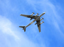 Russian bomber Tu-95 Bear}. Russian long-range strategic bomber Tu-95  in flight Stock Photo