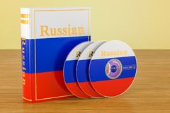 Russian book with flag of Russia and CD discs on the wooden tabl. E. 3D Royalty Free Stock Photo
