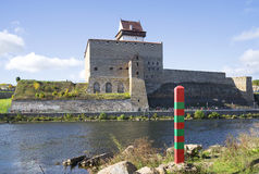 Russian border post on the background of the Narva and the castle Herman Stock Photography