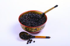 Russian bowl wth black currants Royalty Free Stock Image