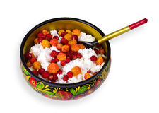Russian breakfast. Strawberries, cloudberries and curds on Khokhloma Stock Image