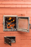 Russian brick oven. With fire close up Royalty Free Stock Photo