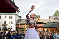 The Russian bride throws a bouquet. royalty free stock photography