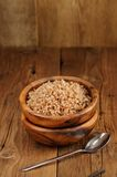 Russian buckwheat kasha in wooden bowl Stock Image