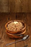 Russian buckwheat kasha in wooden bowl Royalty Free Stock Photo