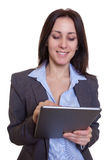 Russian businesswoman working with tablet computer royalty free stock images