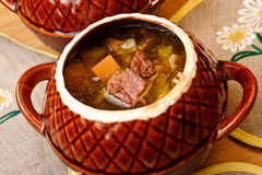 Russian cabbage soup in ceramics pot Royalty Free Stock Photos