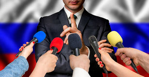 Russian candidate speaks to reporters - journalism concept Stock Images