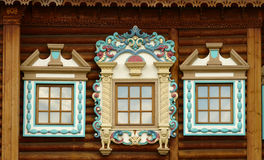 Russian carved wooden frames beautify exterior of timbered house Royalty Free Stock Photography