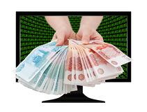 Russian cash in hands out of screen Stock Photos