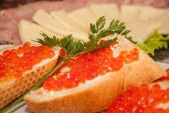 Red caviar. Small sandwiches with red caviar stock photography