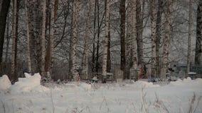Russian cemetery in winter. Under snow in December stock video