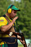 Russian championships in trap shooting. St. Petersburg, Russia - August 4, 2015: Dmitry Chernov with shotgun during the Russian championships in trap shooting Royalty Free Stock Photos