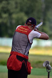 Russian championships in trap shooting. St. Petersburg, Russia - August 4, 2015: Unidentified athlete with shotgun during the Russian championships in trap Royalty Free Stock Photography