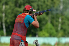 Russian championships in trap shooting. St. Petersburg, Russia - August 4, 2015: Unidentified athlete with shotgun during the Russian championships in trap Stock Photos