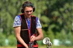 Russian championships in trap shooting. St. Petersburg, Russia - August 4, 2015: Unidentified athlete with shotgun during the Russian championships in trap Royalty Free Stock Photo
