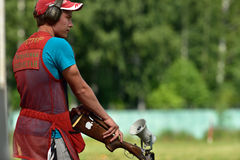 Russian championships in trap shooting. St. Petersburg, Russia - August 4, 2015: Unidentified athlete with shotgun during the Russian championships in trap Stock Photography