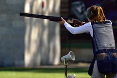 Russian championships in trap shooting. St. Petersburg, Russia - August 4, 2015: Unidentified female athlete with shotgun during the Russian championships in Royalty Free Stock Photos