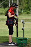 Russian championships in trap shooting. St. Petersburg, Russia - August 4, 2015: Unidentified female athlete with shotgun during the Russian championships in Stock Photos