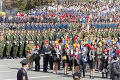 Russian children congratulate veterans on celebration on annual Stock Image
