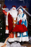 Russian Christmas characters. Ded Moroz (Father Frost) and Snegurochka (Snow Maiden) with gifts bag studio shoot Royalty Free Stock Images