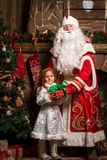 Russian Christmas characters Ded Moroz and Snegurochka. Russian Christmas characters Ded Moroz Father Frost and Snegurochka Snow Maiden standing at the Christmas Stock Images
