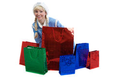 Russian christmas girl with a lot of bright gift Stock Photography