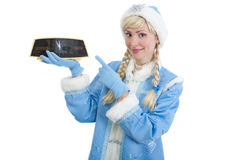 Russian christmas girl point to clock. Smiling girl dressed in traditional russian christmas costume of Snegurochka (Snow Maiden) point to clock. Five minutes Stock Photography