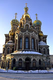 Russian church. Located in St. Petersburg, Russia. Photo made ​​one sunny afternoon in February. The sky is clear of clouds. Sun illuminates the Savior on Stock Images