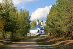 Russian church in autumn forest Royalty Free Stock Images