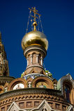 Russian Church Cupola. The cupola of the famous Church of the Saviour on the Spilled Blood in Saint Petersburg, Russia against a blue sky Royalty Free Stock Images