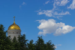 Russian church dome against the blue sky. And clouds trees Stock Photography