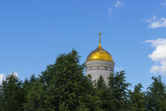 Russian church dome against the blue sky. And clouds trees Stock Photo