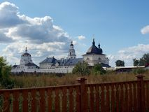 Russian monastery on the island of Sviyazhsk behind the fence landscape beautiful sky. Russian Church on the island of Sviyazhsk behind the fence landscape royalty free stock image