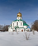 Russian church. Orthodox Russian Church with golden cupola and icons on the wall in winter day Stock Images