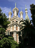 Russian Church in Sanremo Italy. Russian Church in Sanremo on the Italian Riveria showing Byzantine Orthodox crosses and domes plus palm trees Stock Images