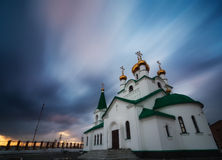 Russian church at sunset Stock Photos