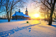 Russian church in winter forest. Small russian church in winter park at sunset Stock Image